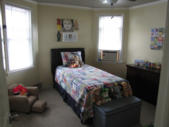 "Mini-man chair to the left. Toy box and stuffed ""friends"" at the foot of the bed. Dresser to the right."