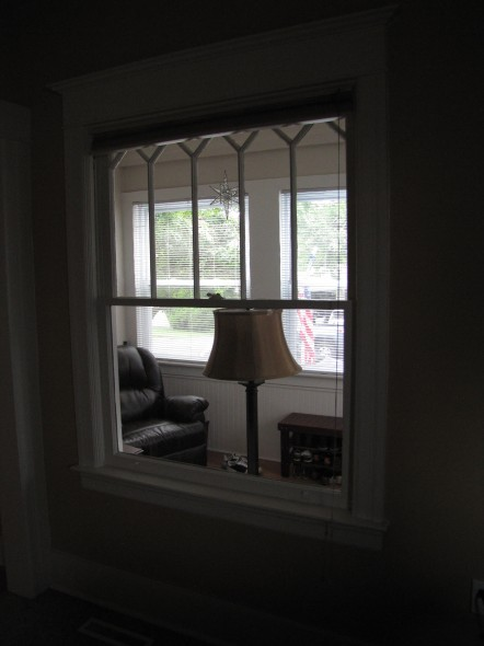 Looking from the living room out onto the sun porch. Original window = swoon.