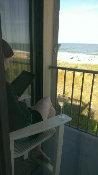 Not my all-time favorite picture of myself. But I am unshowered, I have wine, a good book, and a beach view. If that's not perfection, I don't know what is.