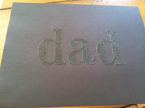 Step 1: Place large DAD letter sticks on construction paper. I repurposed these (originally purchased at Michael's) from another craft project and tested them to make sure they would pull off the paper fairly easily.